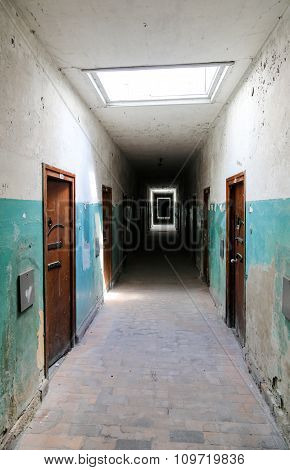Old Corridor With Doors As If In A Hospital Or Prison.