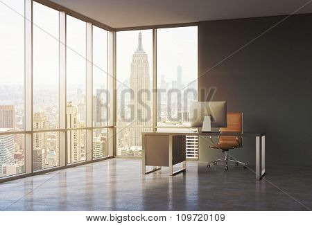 A Workplace In A Modern Corner Panoramic Office With Sunset New York View. A Black Desk With A Moder