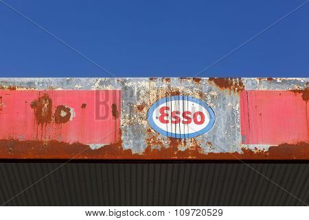 Old and vintage logo of Esso on an abandoned gas station