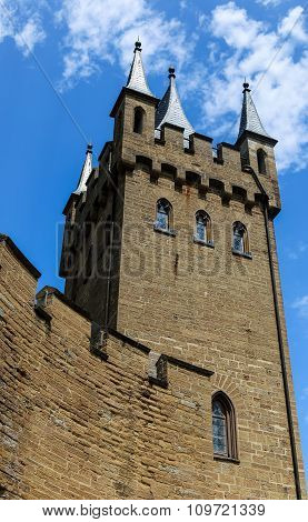 Castle Tower Walls With Windows And Blue Sky.