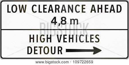Road Sign In The Philippines - Low Clearance Ahead, High Vehicles Detour