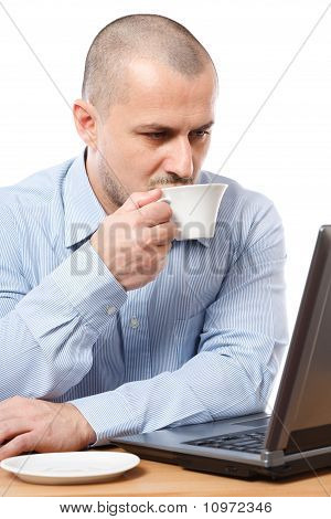 Businessman With Coffee Reading On Computer Screen