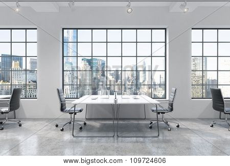 Workplaces In A Bright Modern Loft Open Space Office. Tables Are Equipped With Modern Computers. New