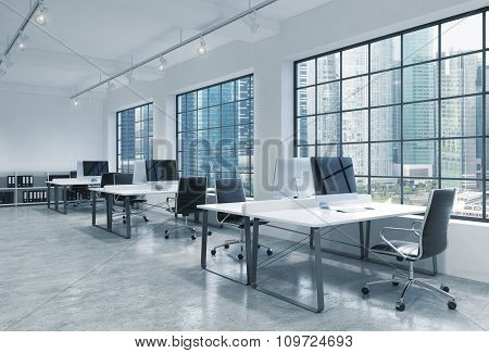 Workplaces In A Bright Modern Loft Open Space Office. Tables Are Equipped With Modern Computers; Boo