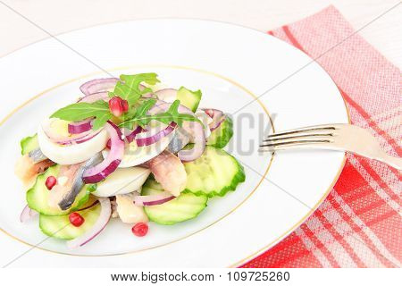 Dietary Food: Salad with Herring, Cucumber, Egg and Onion.