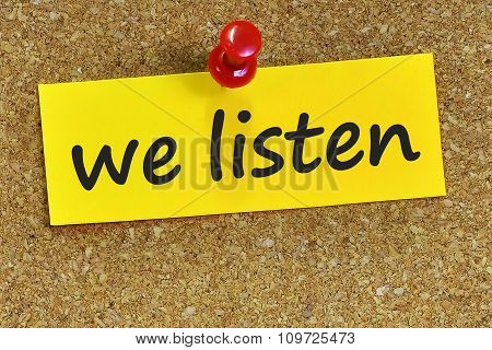 We Listen Word On Yellow Notepaper With Cork Background