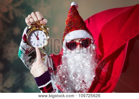 Funky Santa Claus with alarm clock wearing heart shape sunglasses