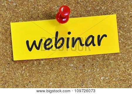 Webinar Word On Yellow Notepaper With Cork Background