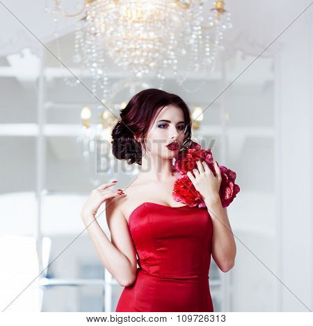 Beauty Brunette model woman in  evening red dress. Beautiful fashion luxury makeup and hairstyle, on