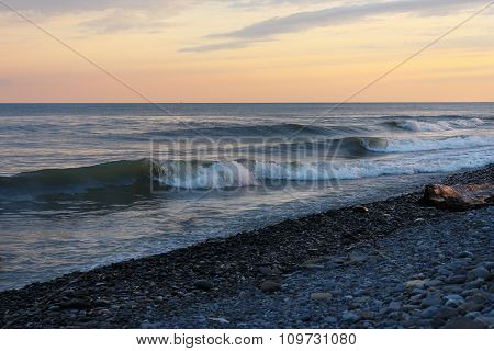 Calm waves on the beach in evening