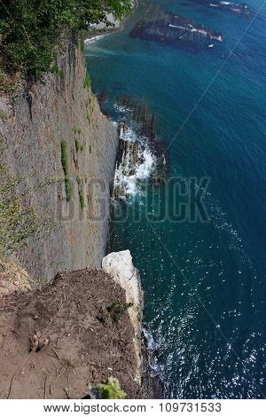 Dizzying view from high cliffs down to the sea