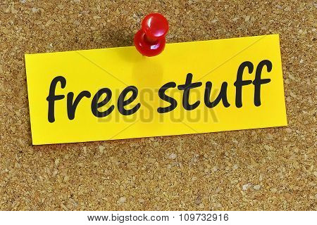 Free Stuff Word On Yellow Notepaper With Cork Background