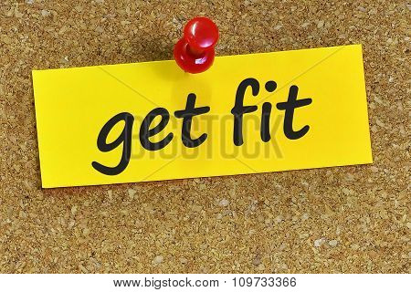 Get Fit Word On Yellow Notepaper With Cork Background