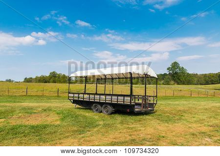 Covered Wagon With White Top In Farm.