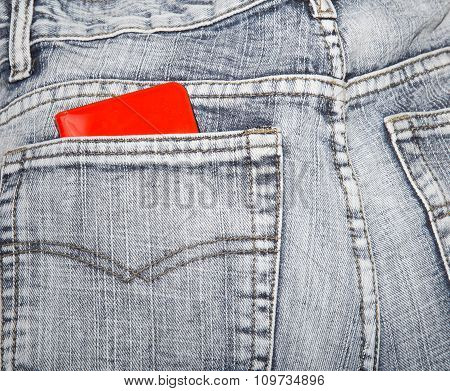 Red Wallet In A Hip-pocket Of Blue Jeans