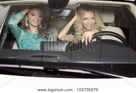 Gorgeous Women With Long Hair Wear Luxurious Dresses,posing In Car