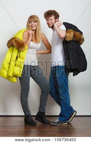 Happy Couple Man And Woman With Fashion Jackets.