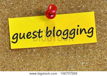 Guest Blogging Word On Yellow Notepaper With Cork Background