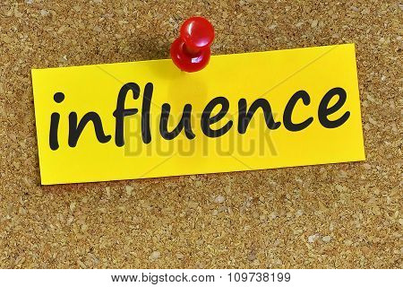Influence Word On Yellow Notepaper With Cork Background