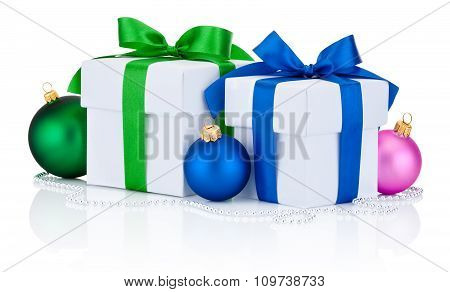 Two White Gift Boxes Tied Green And Blue Ribbon Bow And Christmas Balls Isolated On White Background