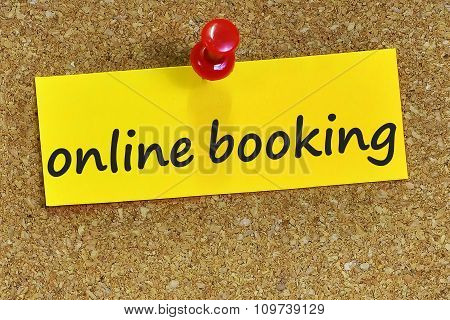 Online Booking Word On Yellow Notepaper With Cork Background