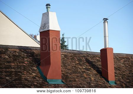 Shingle roof with two chimneys