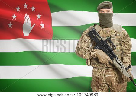 Soldier Holding Machine Gun With Flag On Background Series - Abkhazia