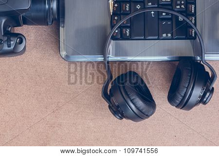 Headphones, Laptop And Camera