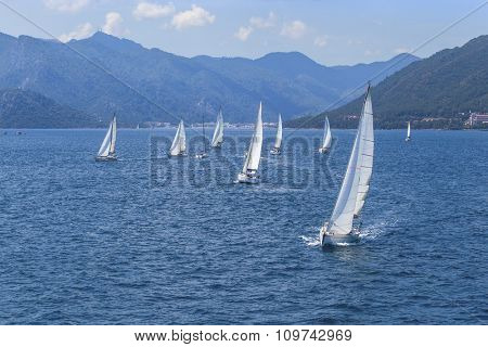Sailing regatta. Sailing in the wind through the waves at the Mediterranean Sea. Luxury yachts.