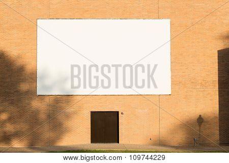 Big Blank Billboard Attached To Brick Wall