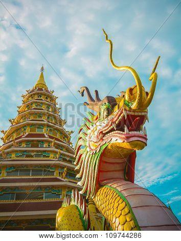 Dragon Statue With Pagoda Of Wat Huay Pla Kang Chiang Rai,thailand