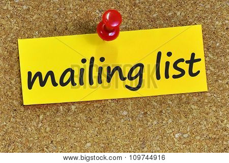 Mailing List Word On Yellow Notepaper With Cork Background