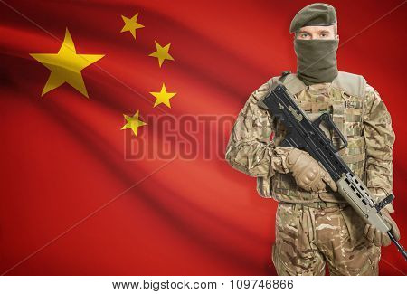 Soldier Holding Machine Gun With Flag On Background Series - People's Republic Of China