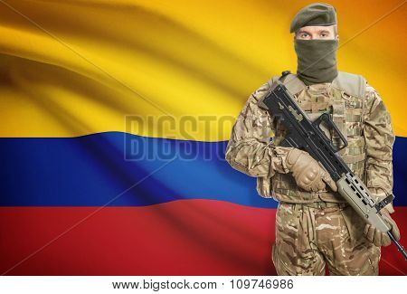 Soldier Holding Machine Gun With Flag On Background Series - Colombia