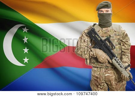 Soldier Holding Machine Gun With Flag On Background Series - Comoros