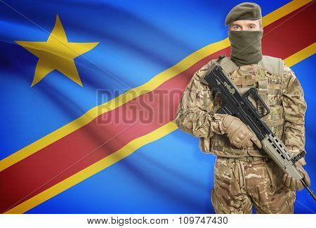 Soldier Holding Machine Gun With Flag On Background Series - Congo-kinshasa