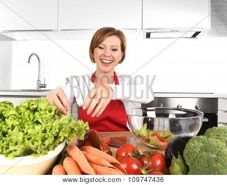 Young Beautiful Woman In Red Apron At Home Kitchen Preparing Vegetable Salad Bowl Smiling Happy