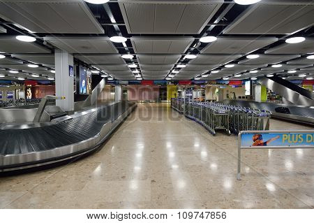 GENEVA, SWITZERLAND - NOVEMBER 18, 2015: Baggage claim area in Geneva Airport. Geneva International Airport is the international airport of Geneva, Switzerland.