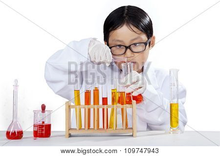 Cute Boy At Chemistry Class And Make Experiment