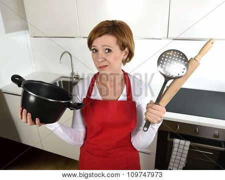Rookie Home Cook Woman In Red Apron At Home Kitchen Holding Cooking Pan And Rolling Pin Sad In Stres