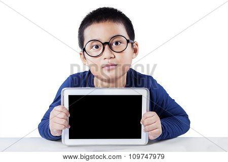 Cute Boy Holds Empty Tablet Screen