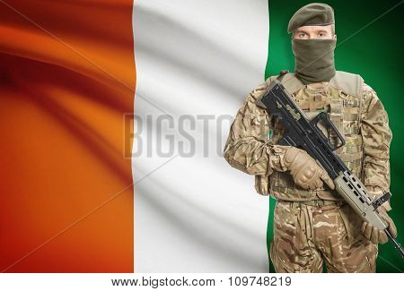 Soldier Holding Machine Gun With Flag On Background Series - Ivory Coast