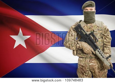 Soldier Holding Machine Gun With Flag On Background Series - Cuba