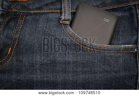 Black Smartphone In Your Pocket Jeans. Background.