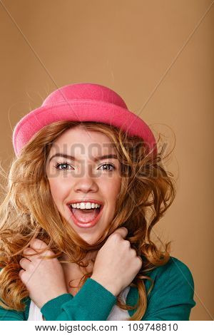 Girl With Curly Hair In A Pink Hat.