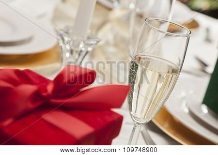 Beautiful Christmas Gift with Place Setting Abstract at Table.