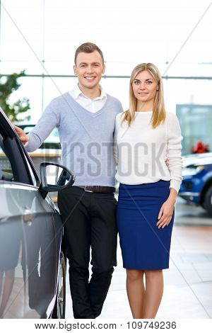 Happy couple going to buy a car