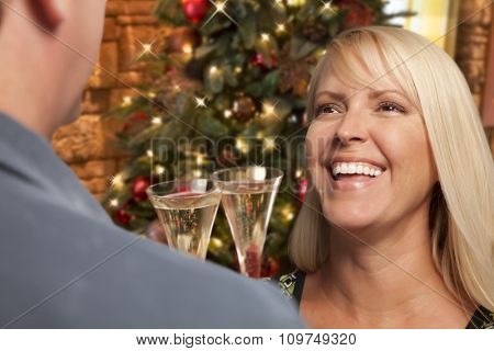 Pretty Girl Socializing with Champagne Glass At Christmas Party.