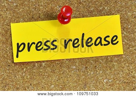 Press Release Word On Yellow Notepaper With Cork Background