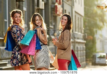 four Women with Shopping Bags